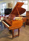 Piano for sale. An antique Steinway Model O grand piano with a polished, satinwood case. Delicately inaid with boxwood stringing and crossbanding. Unusual piano lyre.