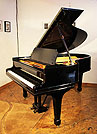 Piano for sale. A 1909, Steinway Model O grand piano with a black case and spade legs. Piano has an eighty-eight note keyboard and a two-pedal lyre