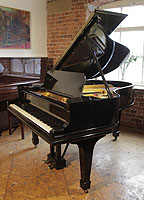 A 1909, Steinway Model O grand piano with a black case and spade legs