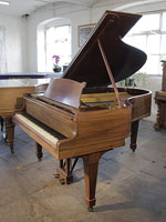 A 1926, Steinway Model O grand piano with a mahogany case and spade legs