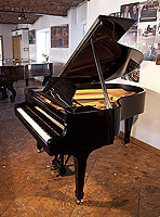 A 1952, Steinway Model O grand piano with a black case and spade legs