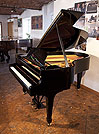 Piano for sale. A 1952, Steinway Model O grand piano with a black case and spade legs. Piano has an eighty-eight note keyboard and a two-pedal lyre.
