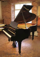 A 1974, Steinway Model O grand piano with a black case and spade legs