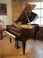 A 1975, Steinway Model O grand piano for sale with a mahogany case and spade legs. Piano has an eighty-eight note keyboard and a two-pedal lyre.