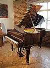 Piano for sale. A 1975, Steinway Model O grand piano for sale with a mahogany case and spade legs. Piano has an eighty-eight note keyboard and a two-pedal lyre.