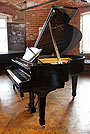 Piano for sale. A A 1951, Steinway Model S baby grand piano with a black case and spade legs