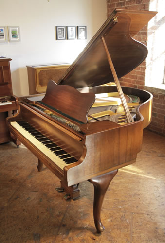 A  1957, Steinway Model S Baby Grand piano for sale with a walnut case and cabriole legs
