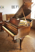 A stunning, 1957, Steinway Model S baby grand piano for sale with a walnut case and cabriole legs