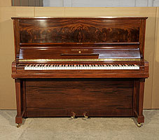 A 1938, Steinway Model V upright piano with a polished, mahogany case. Cabinet features an exquisite, book-matched mahogany front panel