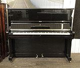 Piano for sale. A 1961, Steinway Model V upright piano with a black case and brass fittings