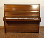 Piano for sale. A 1975, Steinway Model V upright piano with a polished, mahogany case. Piano has an eighty-eight note keyboard and two pedals