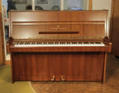 Piano for sale. A 1970, Steinway Model Z upright piano with a mahogany case.
