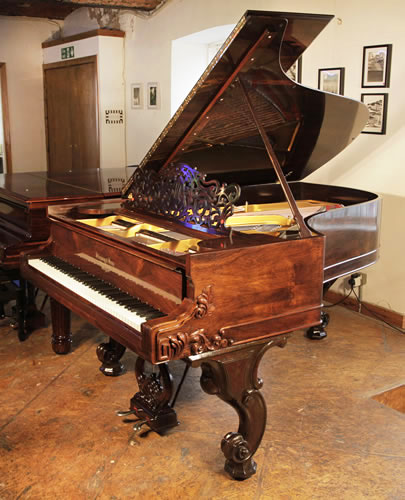 A rebuilt, 1877, Steinway Style 1 grand piano for sale with a rosewood case and carved Rococo style, cabriole legs