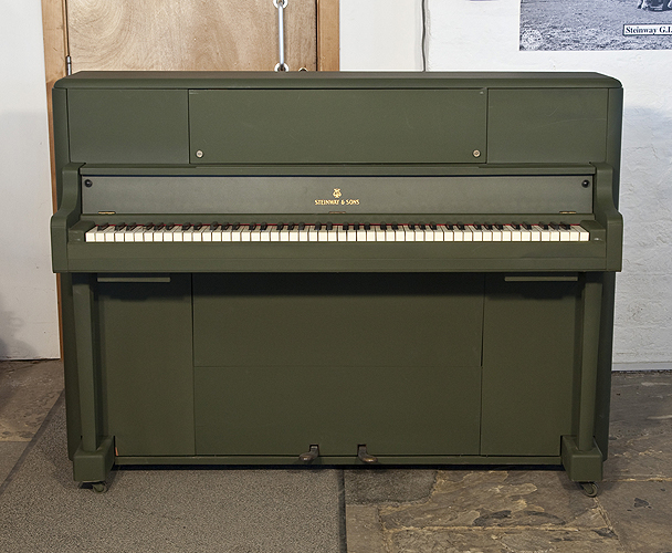 An 1945, Steinway 'Victory Vertical' G.I. upright piano for sale with an olive drab case. This upright was airdropped onto battlefields during WWII for the American troops.