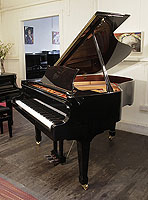 A brand new, Toyama TC-162 grand piano for sale with a black case and spade legs. Piano features a slow fall mechanism on the keyboard lid