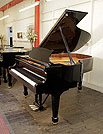 Piano for sale. A brand new, Toyama TC-187 grand piano for sale with a black case and spade legs. Piano features a slow fall mechanism on the keyboard lid.