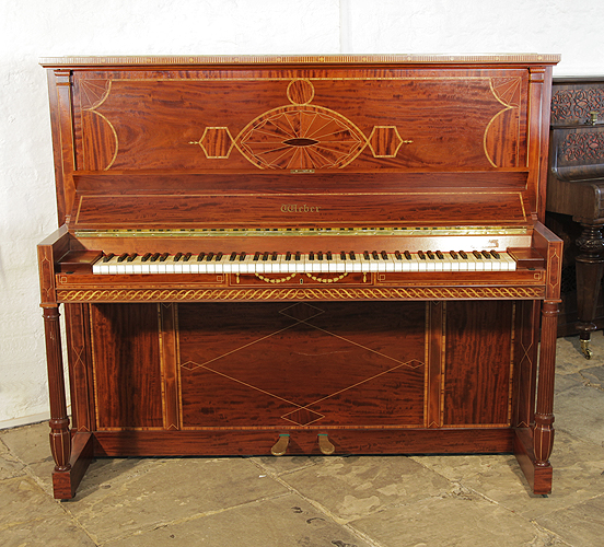 A 1912, Weber upright piano for sale with a flame mahogany case and turned, fluted legs. Cabinet inlaid with a stylised, Neoclassical design featuring geometric forms in a variety of woods