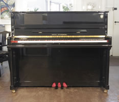 New Steinberg Model AT-K18 upright piano with a black case and brass fittings