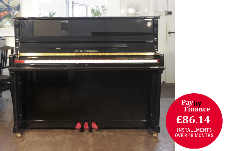 Brand New, Steinberg Model AT-K18  upright Piano for sale with a black case.