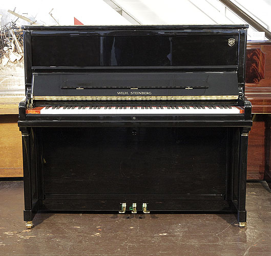 Brand New, Steinberg Model AT-K30  upright Piano for sale with a black case and slow fall. Cabinet features a walnut key block