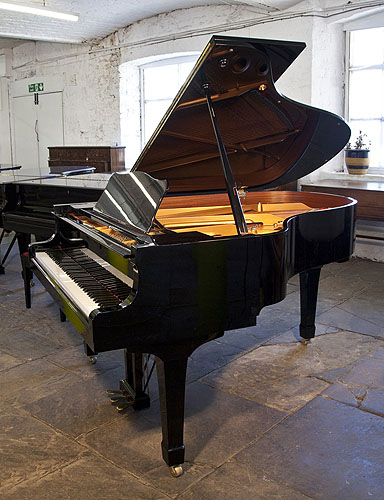 A Yamaha C3 grand piano for sale with a black case and spade legs