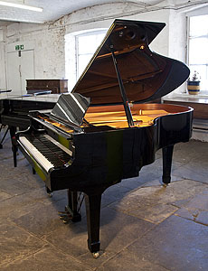 A 2004, Yamaha C3 grand piano for sale with a black case and spade legs