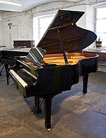 Pre-owned 2004, Yamaha C3 grand piano for sale with a black case and spade legs.
