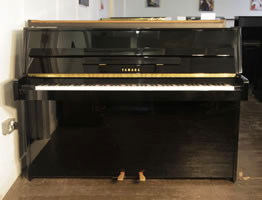 A 2000, Yamaha E108 upright piano with a black case and polyester finish