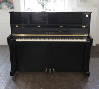 A reconditioned, Yamaha ET121 upright piano for sale with a black case and brass fittings. Price includes: 3 year warranty   |   First tuning free | Free  piano stool | Free delivery to a ground floor residence within mainland UK.  0% finance available subject to terms and conditions.