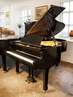 A 1979, Yamaha G3 grand piano for sale with a black case and spade legs