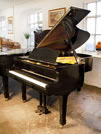 Piano for sale. A 1979, Yamaha G3 grand piano for sale with a black case and spade legs