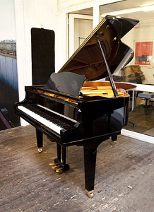 A Yamaha GC1 baby grand piano for sale with a black case and square, tapered legs. Piano features a QuietTime Magic Star system