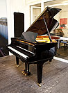 Piano for sale.  A Yamaha GC1 baby grand piano for sale with a black case and square, tapered legs. Piano features a QuietTime Magic Star system