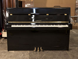 A 1964, Yamaha M5J upright piano for sale with a black case and brass fittings