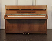Piano for sale. A 1980, Yamaha MJ5 upright piano with a satin, walnut case.