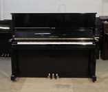 Piano for sale. A 1990, Yamaha U1 upright piano with a black case and polyester finish