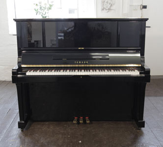A reconditioned, 1983, Yamaha UX-3 upright piano for sale with a black case and brass fittings. Price includes: 3 year warranty   |   First tuning free | Free  piano stool | Free delivery to a ground floor residence within mainland UK.  0% finance available subject to terms and conditions.