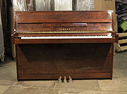 Piano for sale. Yamaha C108 Upright Piano For Sale with a Walnut Case and Brass Fittings