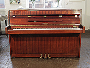 Piano for sale. A 1970, Yamaha upright piano with a mahogany case and polyester finish