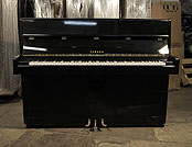 Piano for sale. A 1971, Yamaha Upright Piano For Sale with a Black Case and Brass Fittings