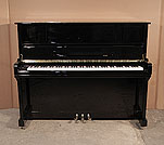 Piano for sale. Hamlyn Klein BJ-118 upright piano with a black case and polyester finish. Keyboard lid features a slow fall mechanism. Piano has an eighty-eight note keyboard and three pedals.