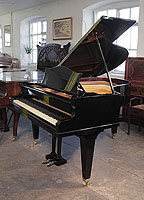 Rebuilt, 1935, Bechstein Model L grand piano with a black case and square, tapered legs