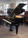 Piano for sale. A 1935, Bechstein Model L grand piano with a black case and square, tapered legs