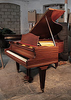 A 1935, Bechstein Model L grand piano with a polished, mahogany case and square, tapered legs.