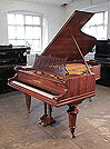 Restored, 1895, Bechstein Model VA grand piano for sale with a rosewood case, filigree music desk in a stylised floral design and turned legs.