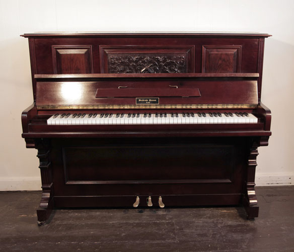 Besbrode Upright Piano For Sale with a Mahogany Case and Carved, Front Panel in a Neoclassical Design