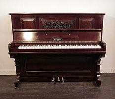 Besbrode upright piano with a mahogany case and carved, front panel in a Neoclassical design