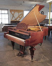 Piano for sale. An 1879, Bosendorfer grand piano for sale with a filigree music desk, mahogany case and turned legs. Piano has an eighty-eight note keyboard and a two-pedal lyre.