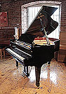 Piano for sale. A 1998, Boston GP163 II baby grand piano for sale with a black case and spade legs.