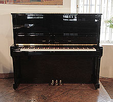A 2000, Boston UP-132E Upright Piano For Sale with a Black Case and Brass Fittings